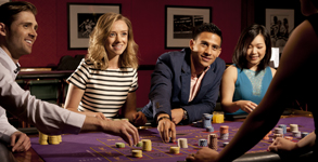 Members placing bets on Roulette table