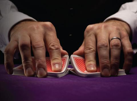 Dealer shuffling playing cards