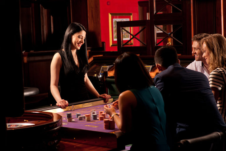 People having a great night out in a casino.