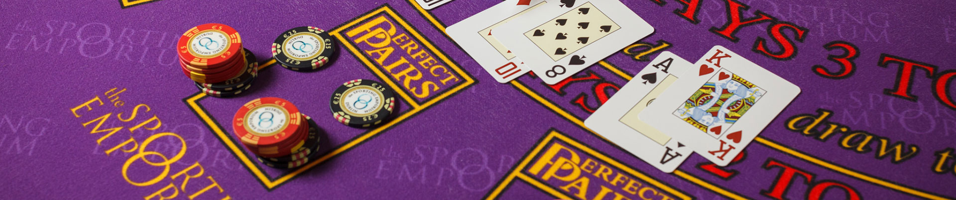 Cards and Tokens on Purple Blackjack Table