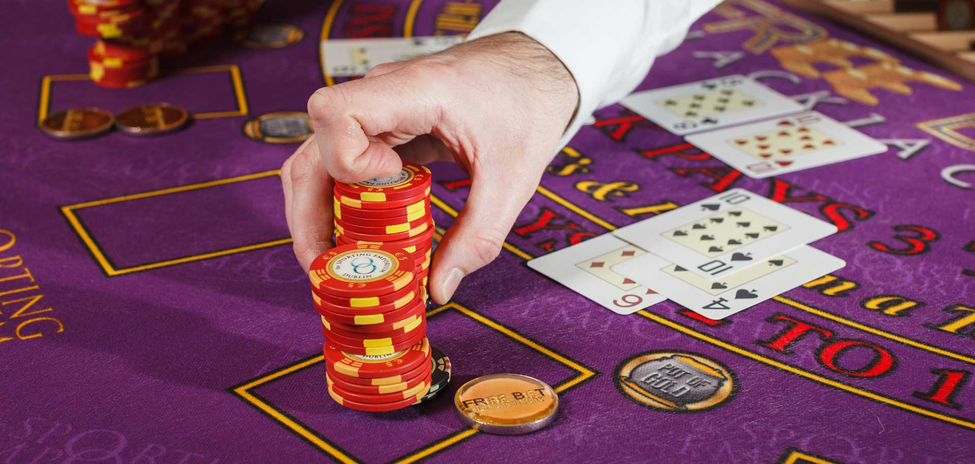 Casino tokens on blackjack table