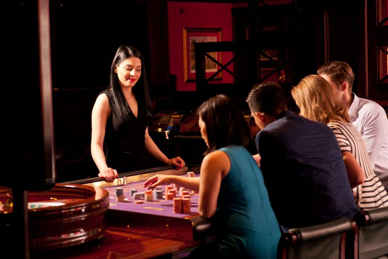 People playing blackjack at a table