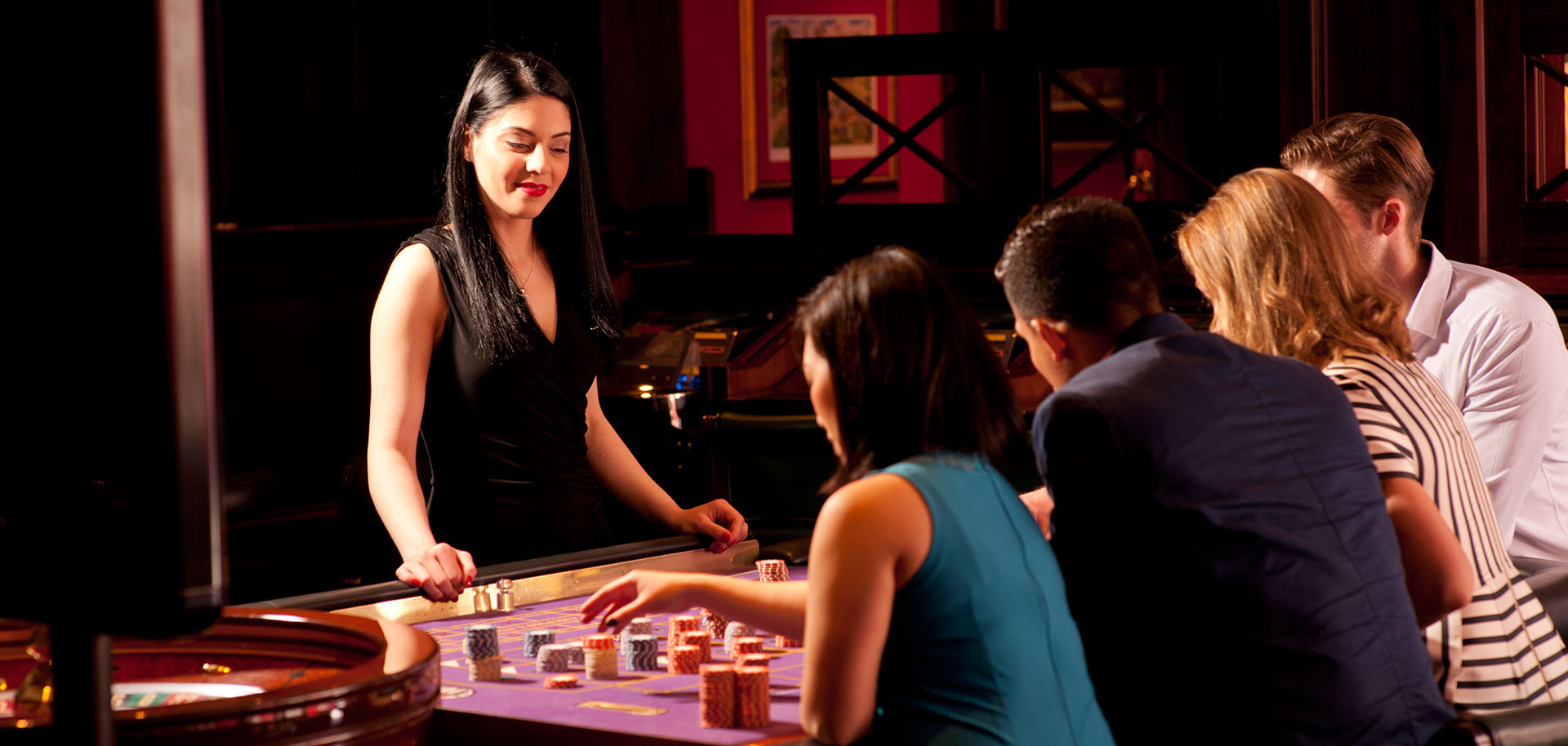 Roulette dealer waiting for players to bet.