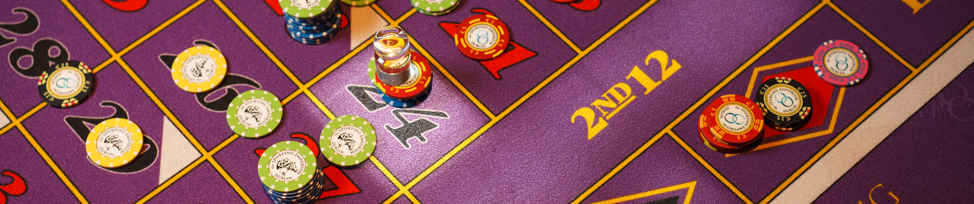 A roulette table with casino tokens